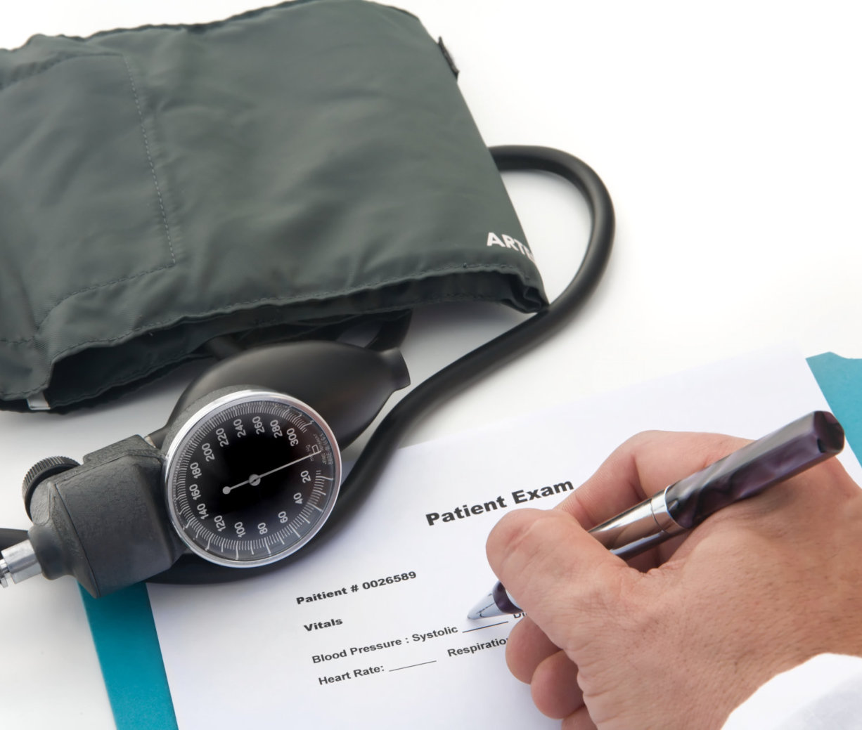 doctor writting patient report