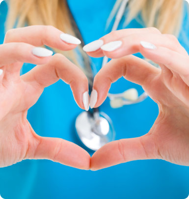 nurse doing heart shaped in her fingers