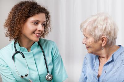 nurse looking at the senior woman