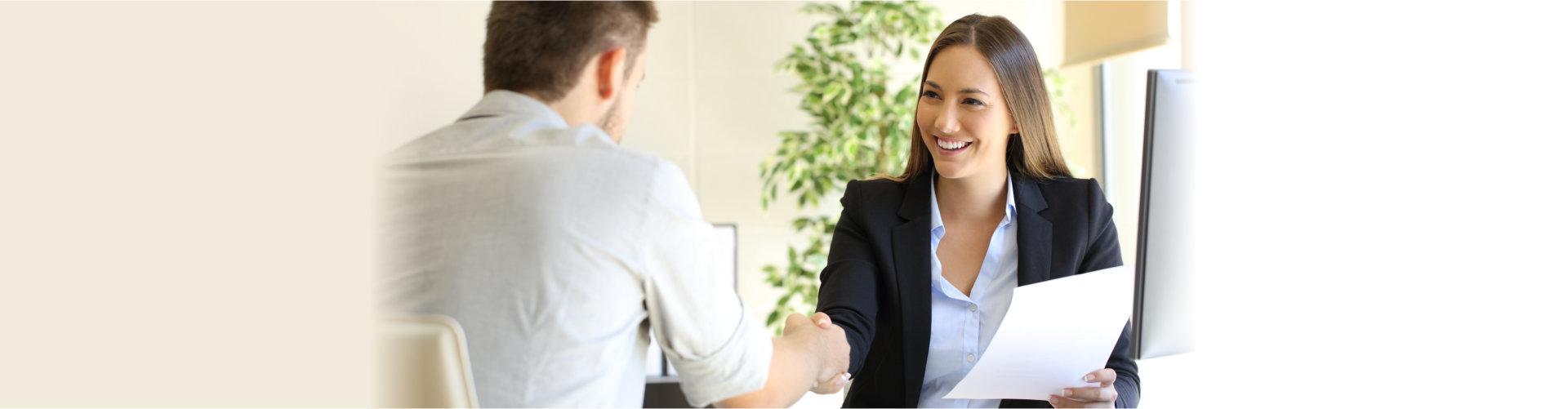 man and woman doing hand shake